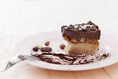 Half eaten raw vegan cake. A raw vegan snickers cake has just be eaten for half and it looks delicious Stock Images