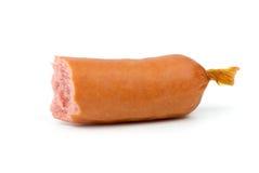Half-eaten sausage Stock Image