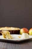 Half eaten slice of apple pie a la mode, vertical Royalty Free Stock Image