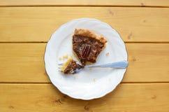 Half-eaten slice of pecan pie Royalty Free Stock Photos