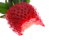 Half eaten strawberry Stock Photography