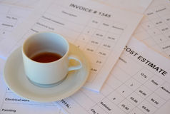 Free Half Empty Cup Of Tea On Financial Documents Royalty Free Stock Image - 14310576