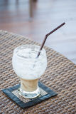 Half empty  ice coffee glass. Stock Photos