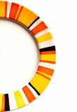 Half of an empty plate. With colorful ring Royalty Free Stock Photography