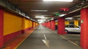 Half empty underground garage or parking. Cameraman walking along the path stock footage