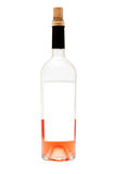 Half empty wine bottle. On white background with blank label Royalty Free Stock Photos