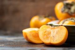 Half en gesneden dadelpruimfruit Stock Fotografie
