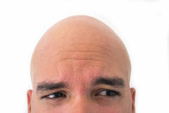 Half face of bald man in white background. Closeup of the eyes. Afraid mood Stock Images