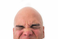 Half face of bald man in white background. Closeup of the eyes closed. Overwhelmed expression Stock Photography