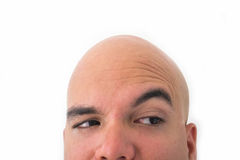Half face of bald man in white background. Closeup of the eyes. Incredulous face Stock Photo