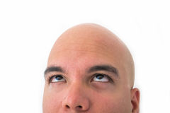 Half face of bald man in white background. Closeup of the eyes to the top Stock Photo