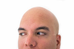 Half face of bald man in white background. Closeup of the eyes turned to the left Royalty Free Stock Image
