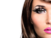 Half face beautiful brunette woman with bright fashion make-up. Half face beautiful brunette woman with bright fashion eyes and lips make-up Stock Images