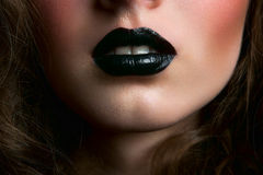 Half face with black lips Stock Photos