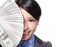 Half face of a business woman and money Stock Photo