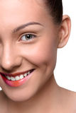 Half face of cheerful, happy young woman with Royalty Free Stock Image