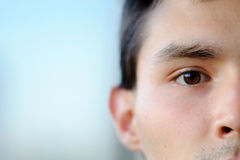 Face closeup. A half-face close-up portrait of a boy with a brown eyes Stock Images