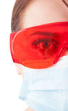 Half face of dentist woman wearing mask and protective glasses Royalty Free Stock Photo