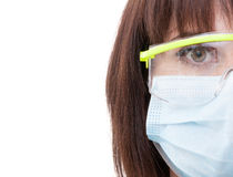 Half face of a dentist woman wearing protection glasses Royalty Free Stock Images
