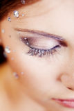 Half face with eye make-up and sparkles Stock Photo