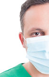 Half face of a handsome male doctor. With surgical mask Royalty Free Stock Image