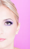 Half face of lady with professional trendy make-up Stock Photo