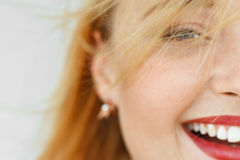 Half face of laughing red-haired woman. Close-up portrait of sunny adorable carroty girl with freckles. Blurry live dynamic photo, free space Stock Photography