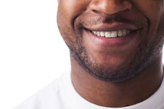 Half-face of man sincerely smiling. Royalty Free Stock Image