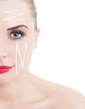 Half face portrait of beautiful woman with facelift arrows Royalty Free Stock Photography