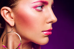 Half face portrait of female with pink make up Stock Photography