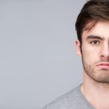 Half face portrait of a handsome young man Royalty Free Stock Photography