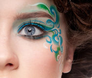Half face portrait of sprite girl with faceart Stock Photo