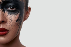 Half Face Portrait of Woman with creative Makeup Stock Images
