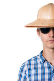 Half face shot of a guy with a straw hat with sunglasses. Isolated on white background Royalty Free Stock Photography