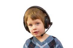 Portrait of happysmiling happy boy listening to music with earphones Stock Images