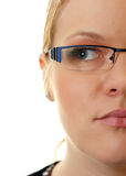 Half face woman. Half face portrait of a blond woman wearing glasses on white background stock photo