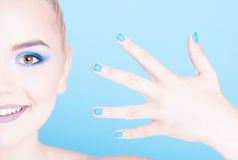 Half face of woman with matching nails and make-up Stock Photography