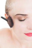 Half face of woman wearing make-up and using brush Royalty Free Stock Photos