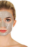 Half face of young woman with facial mask Stock Image