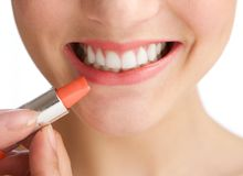 Half face young woman smiling with lipstick Royalty Free Stock Image