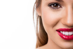 Half female face with great smile Royalty Free Stock Image