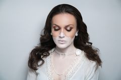 Half of female face is shaded with beige foundation woman make up royalty free stock photos