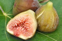 Half of figs and fig whole Stock Photos