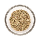 Half filled bowl of Organic Fennel seed. Top view of Organic Fennel seed (Foeniculum Vulgare) half filled in glass bowl isolated on white background royalty free stock photos
