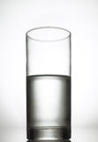 Half filled glass. Half filled, half full glass of water Stock Images