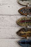 Half fish body pottery on wooden background Royalty Free Stock Images
