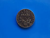 Half frankmuntstuk, Frankrijk over blauw Stock Foto's