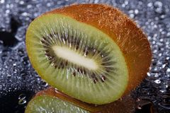 Half fresh kiwi with water drops macro Royalty Free Stock Photography