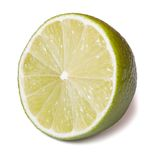 Half of fresh lime isolated on a white background. Closeup Royalty Free Stock Photos