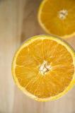 Half of fresh orange. Close up half of fresh orange on top Stock Photos
